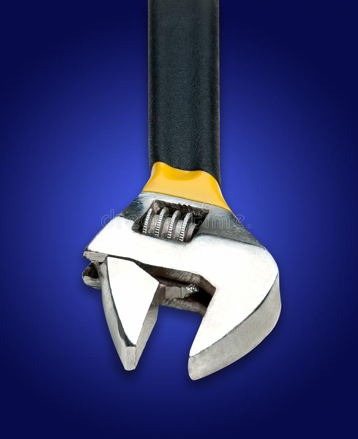 Adjustable Wrench on Blue Background. On studio tabletop royalty free stock image