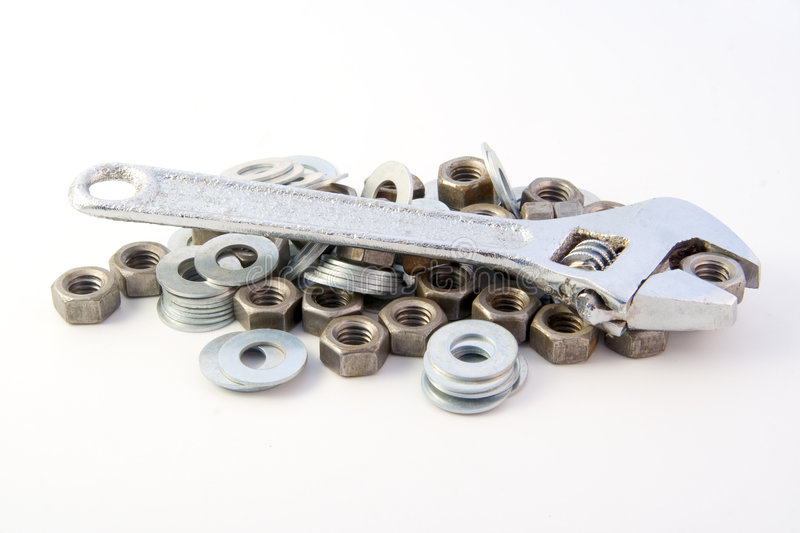Adjustable wrench & nuts. Adjustable wrench isolated on white background stock photography