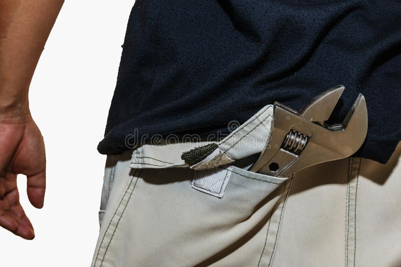 Adjustable Wrench. In the pants pocket stock photo