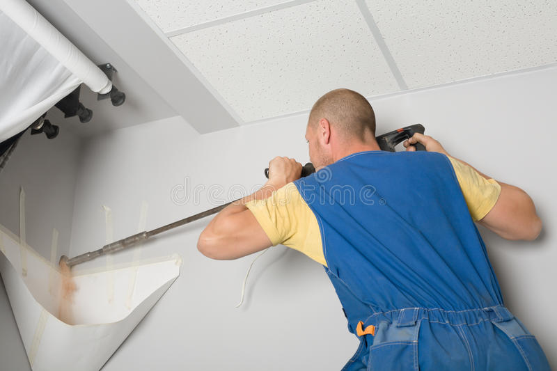 Download Adjuster Works With A Drill Royalty Free Stock Photo - Image: 14887815
