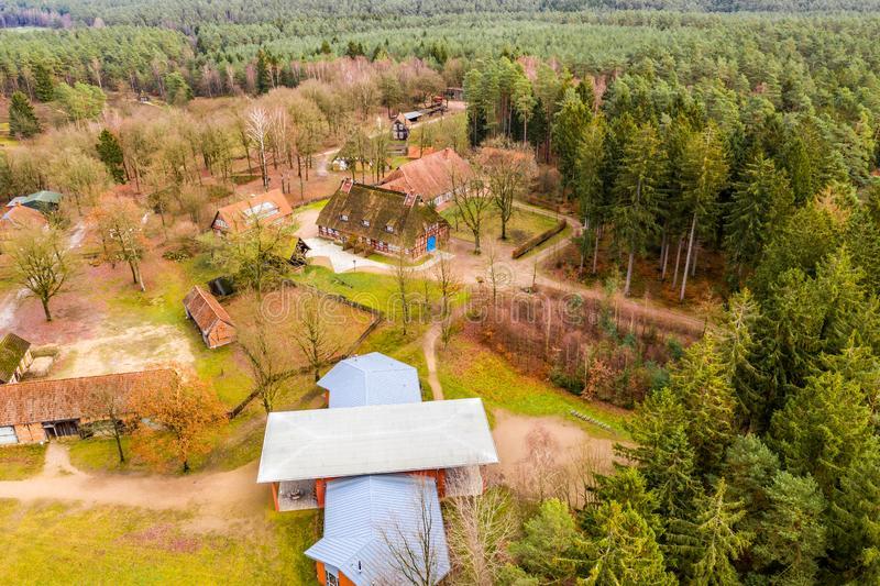 Administration building of the open-air museum Hösseringen in the Lünebürger Heide near Suderburg from the air, with historical. Farmhouses and royalty free stock images