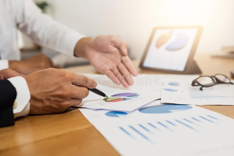 Administrator business man financial inspector planning with accountant secretary making report, discussing the charts and graphs royalty free stock image