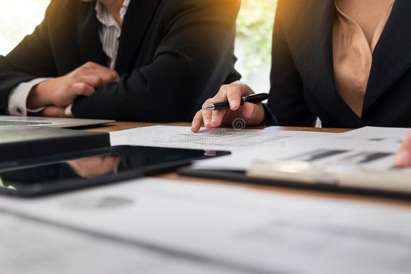 Administrator business man financial inspector and secretary making report, calculating balance. Internal Revenue Service royalty free stock photography