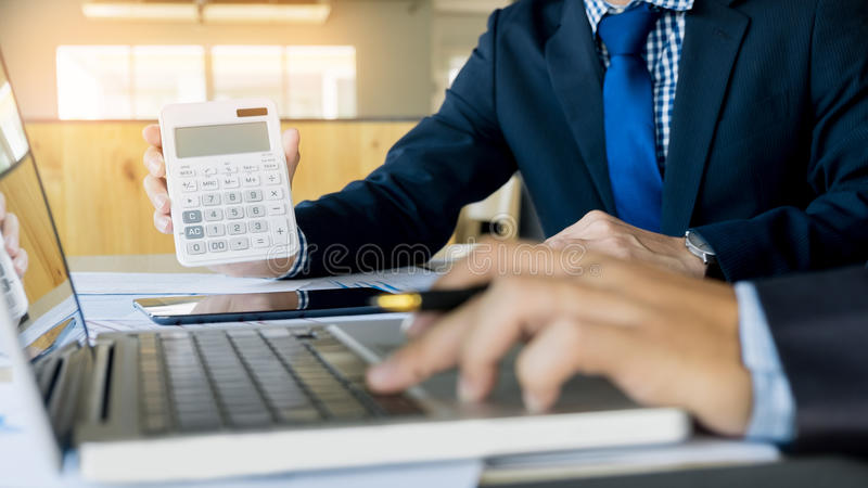 Administrator business man financial inspector and secretary making report, calculating or checking balance. Internal Revenue royalty free stock photos