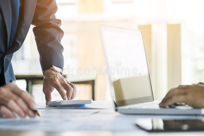 Administrator business man financial inspector and secretary making report, calculating or checking balance. Internal Revenue stock images