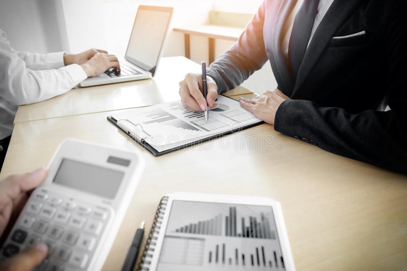 Administrator business man financial inspector and secretary making report, calculating or checking balance. Internal Revenue stock photos
