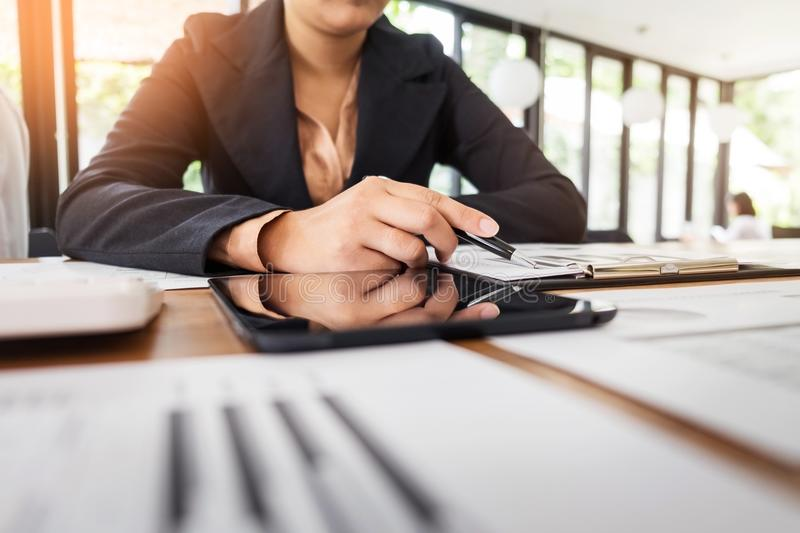 Administrator business man financial inspector and secretary making report, calculating balance. Internal Revenue Service stock photography