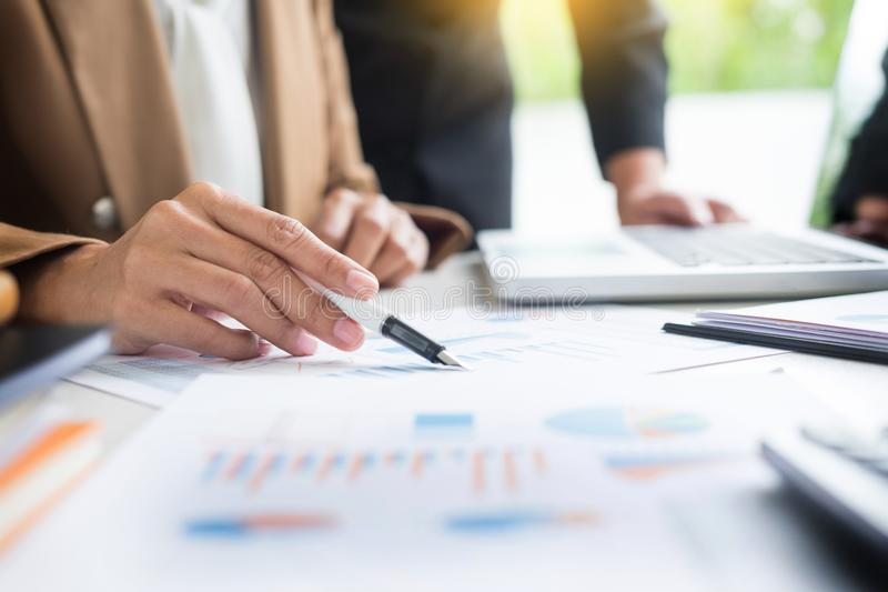Administrator business man financial inspector and secretary making report, calculating balance. Internal Revenue Service stock photo