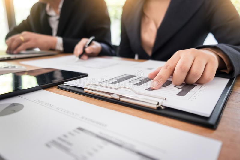 Administrator business man financial inspector and secretary making report, calculating balance. Internal Revenue Service royalty free stock images
