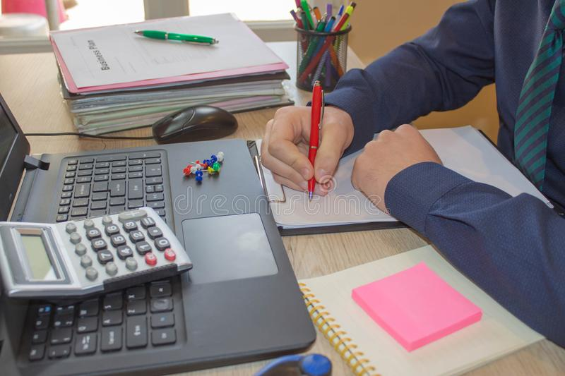 Administrator business man financial inspector and secretary making report, calculating or check balance. Internal Revenue Service royalty free stock image