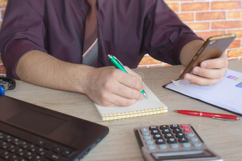 Administrator business man financial inspector and secretary making report, calculating or check balance. Internal Revenue Service royalty free stock photos