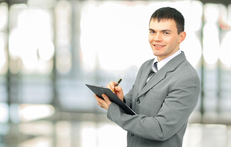 Administrator with the documents. Responsible administrator with the documents royalty free stock photography