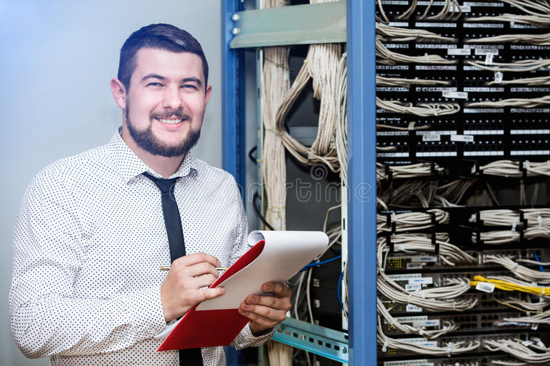 IT administrator at the server. Customer Support stock image