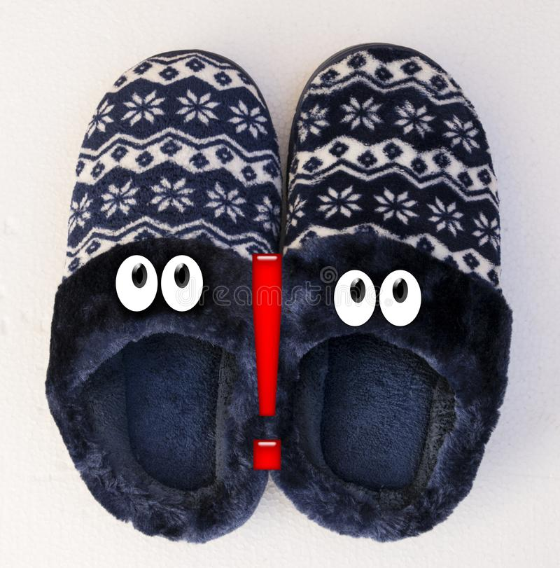 Admiration. Representation of two faces of admiration with slippers stock photo