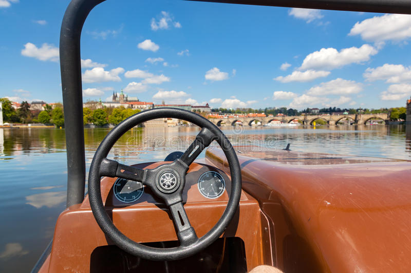 Admiring Prague from paddle boat on Vltava river in Prague, Czech Republic. Popular tourist attraction royalty free stock photo