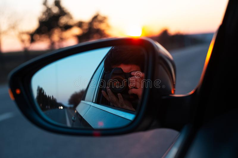 Admiring the sunset through the car window royalty free stock photography