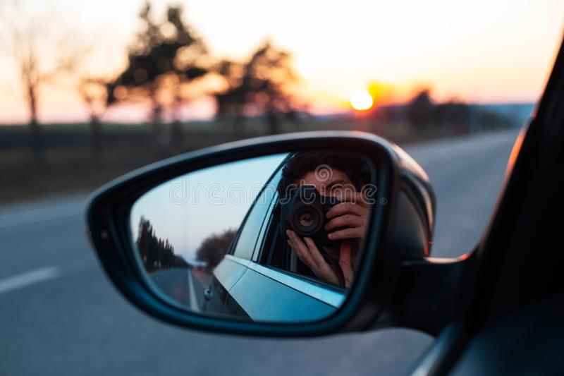 Admiring the sunset through the car window royalty free stock photo