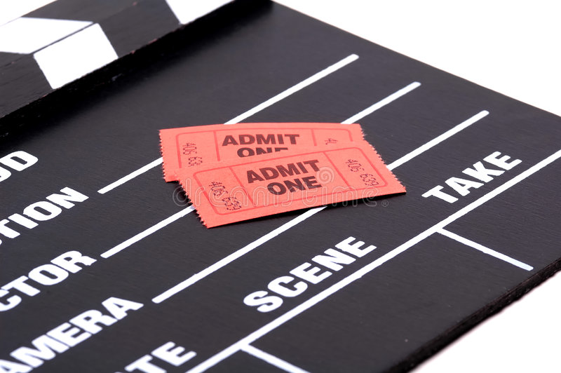 Admission Tickets. Admit One Tickets on a Movie Clapboard royalty free stock photos