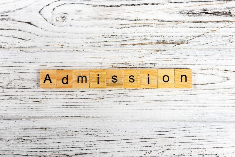 ADMISSION word made with wooden blocks concept.  royalty free stock images