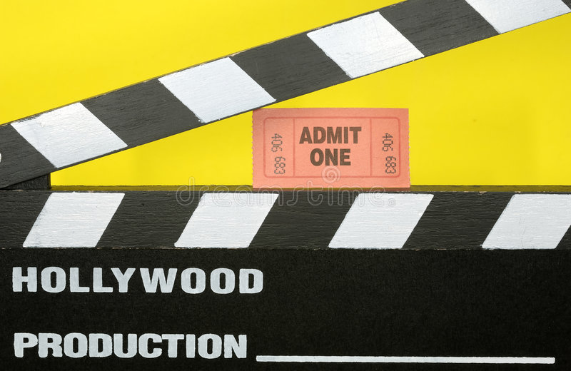 Admit One. Photo of a Hollywood Movie Slate and a Admit One Ticket - Movie Concept royalty free stock photos