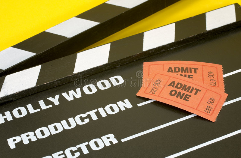 Admit One. Photo of a Hollywood Movie Slate and a Admit One Ticket - Movie Concept stock photo