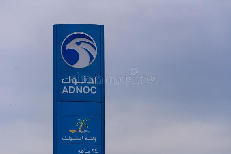 Adnoc  gas or petrol sign in the United Arab Emirates. `Ras al Khaimah, RAK/United Arab Emirates - 4/10/2019: Adnoc  gas or petrol  station sign in English and stock images