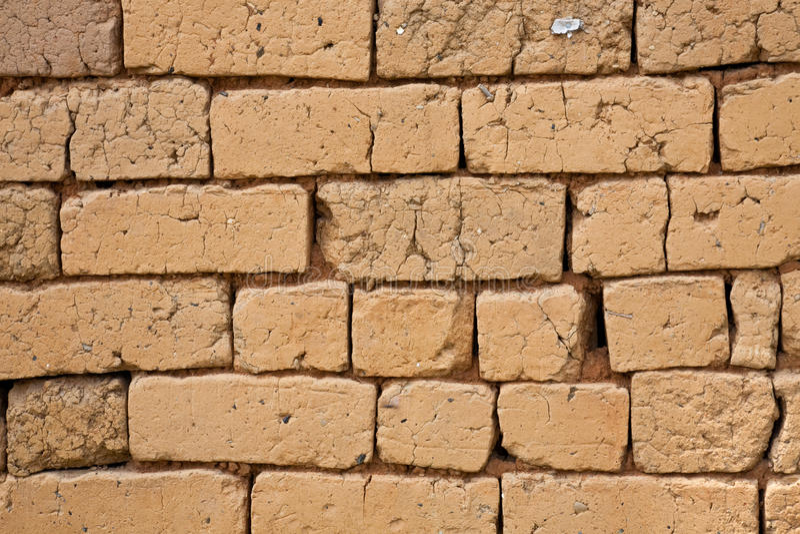Adobe brick wall stock photo