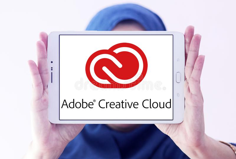 Adobe Creative Cloud logo. Logo of Adobe Creative Cloud on samsung tablet holded by arab muslim woman. Adobe Creative Cloud is a set of applications and services stock photo