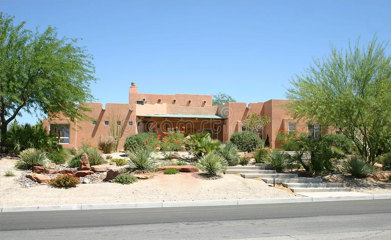 Adobe Home. A traditional adobe home with a lovely desert landscape royalty free stock photography