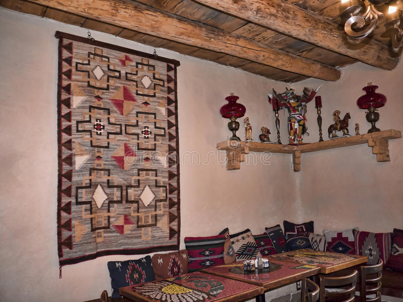 Adobe interior in Taos New Mexico. The adobe town of Taos, seated on the high desert mesa at the foot of the Sangre de Cristo Mountains stock images