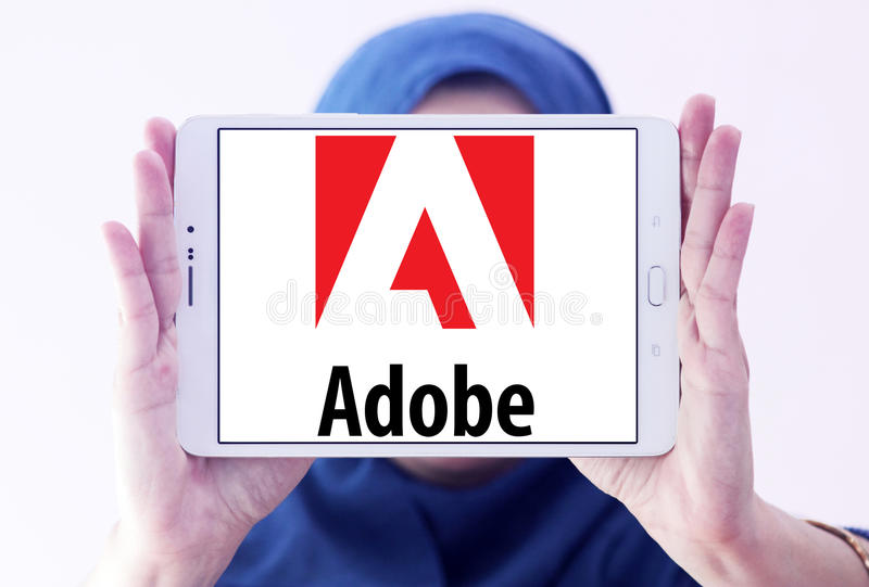 Adobe logo. Logo of adobe company on samsung tablet holded by arab muslim woman royalty free stock photography