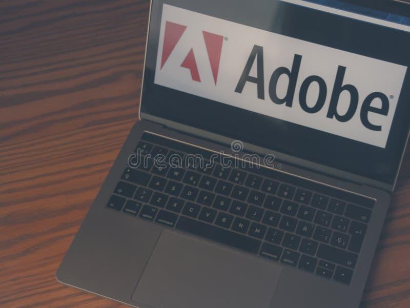 Adobe logo on laptop screen stock photography