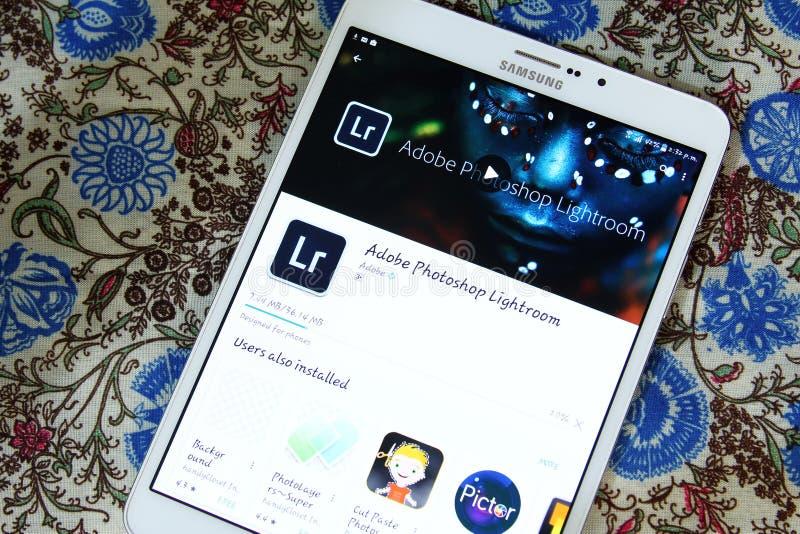 Adobe photoshop lightroom app. Downloading Adobe photoshop lightroom app from google play store on samsung tablet stock image