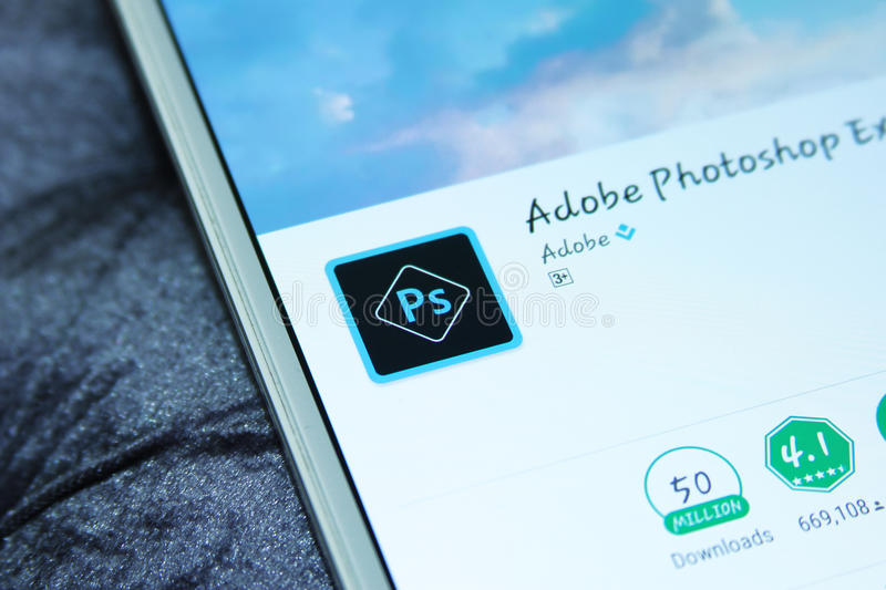 Adobe photoshop mobile app. Downloading Adobe photoshop mobile app from google play store on samsung tablet royalty free stock images