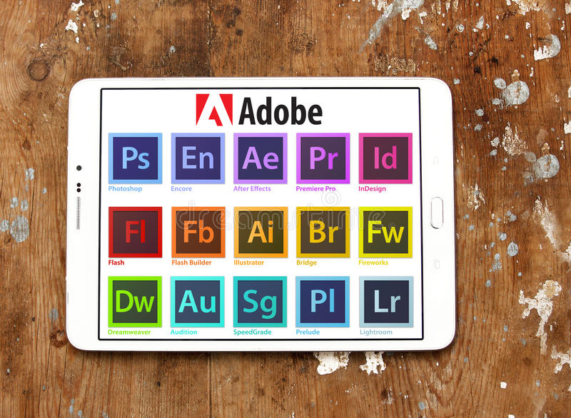 Adobe programs logos and icons. Icons and logos of adobe programs on white tablet on wooden background. programs like photoshop, encore, after effects, premiere stock photos