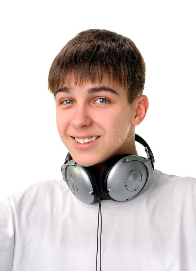 Download Adolescent Avec Des écouteurs Image stock - Image du heureux, musique: 56484809