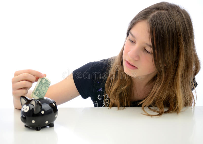 Adolescent avec l'épargne du dollar images libres de droits