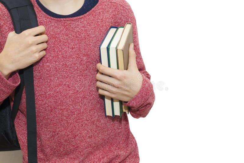 Adolescent avec le sac à dos et les livres d'école images libres de droits