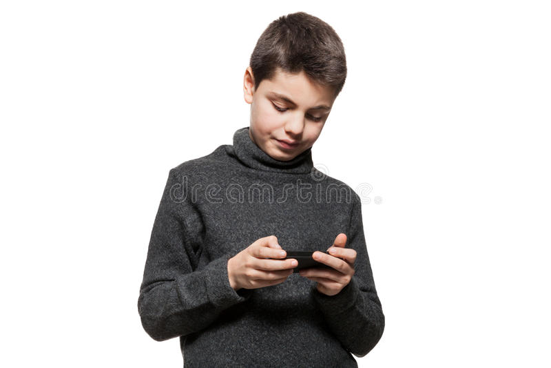 Adolescent avec le téléphone intelligent photos stock