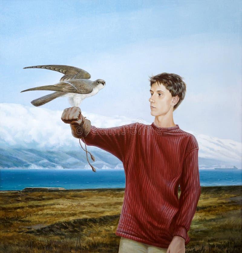 Adolescent avec un faucon photo stock
