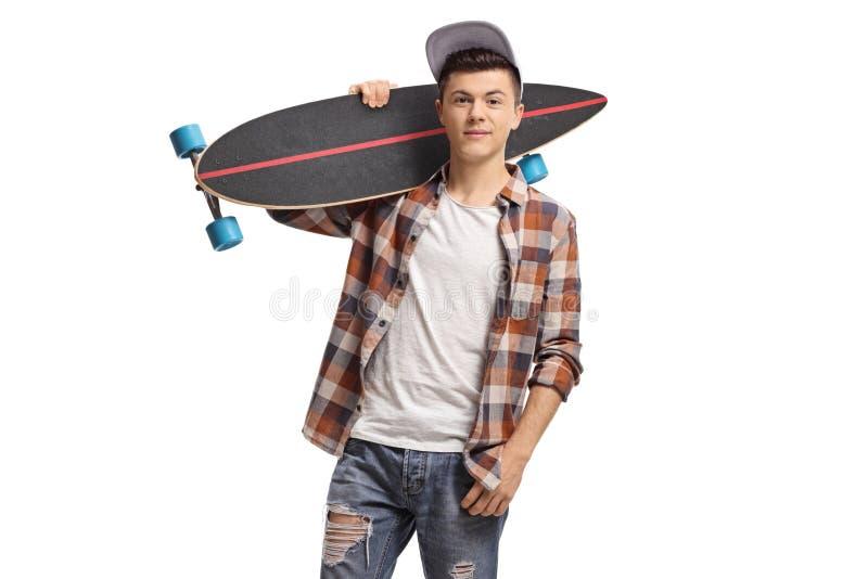 Adolescent avec un longboard photo libre de droits