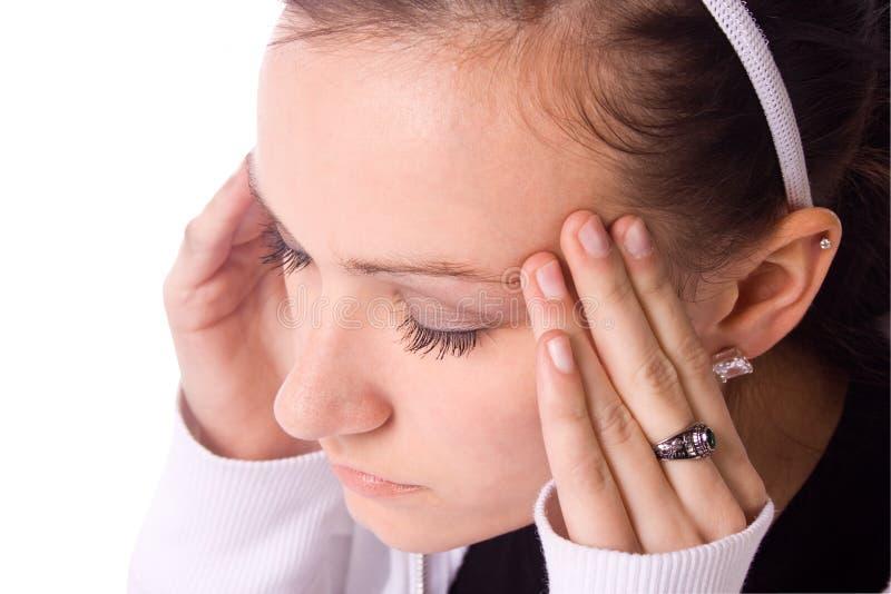 Adolescent avec un mal de tête photo libre de droits