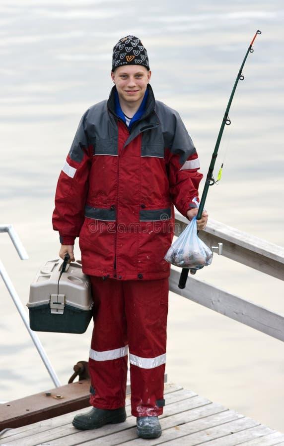 adolescent de palan de pêche images libres de droits