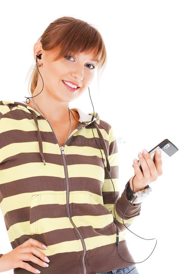 Adolescent de sourire avec le téléphone portable image libre de droits