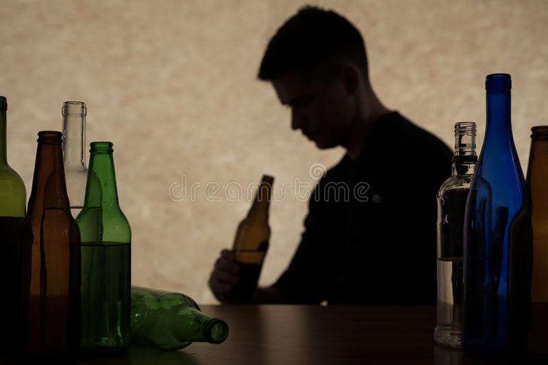 Adolescent drinking beer. Alcoholism among young adults stock photography