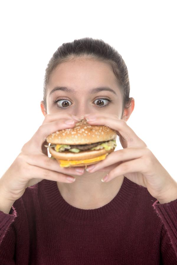 Young Girl with a hamburger stock photos