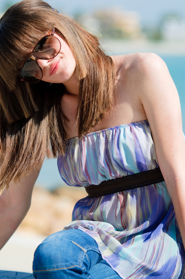 Adolescent girl with sunglasses stock images