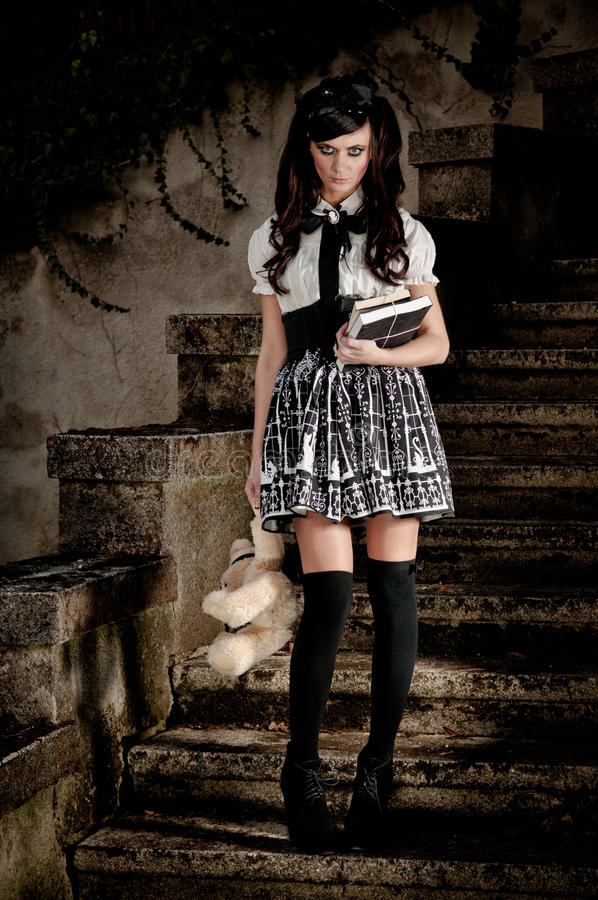 Adolescent Lolita schoolgirl. Adolescent beautiful Lolita schoolgirl looking forlorn and insecure as she exudes an air of precocious sexuality stock photo