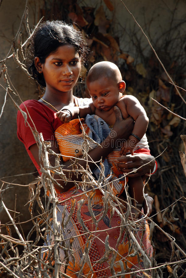 Adolescent Mother in rural India. June 02,2011 Rampurhut,Birbhum,West Bengal,India,Asia- A poor adolescent mother holding her child. In India adolescent girls at royalty free stock image