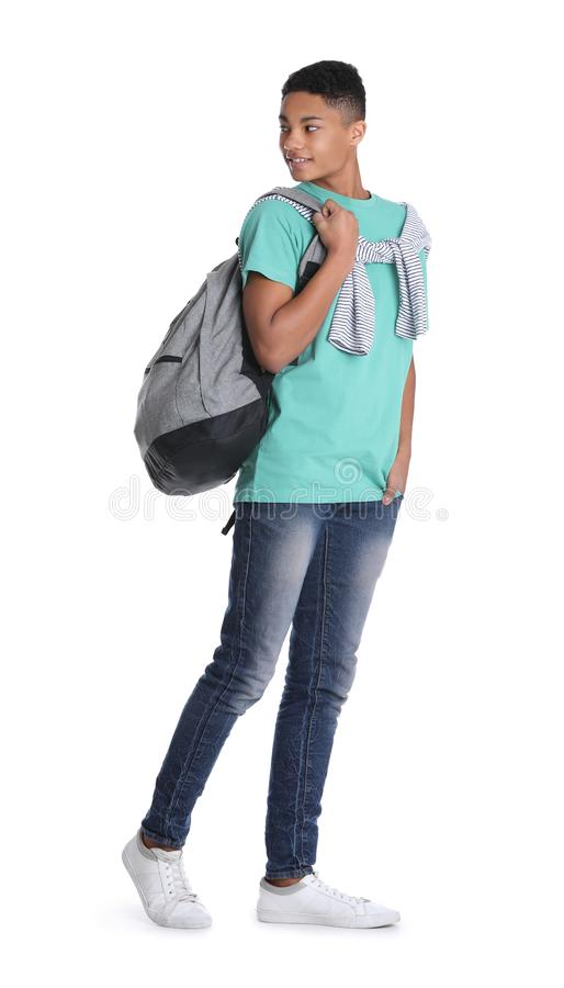 Adolescente afro-americano com a trouxa no branco fotografia de stock royalty free